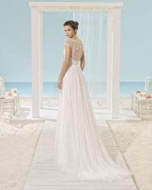 Xenop har en smuk ryg, dækket med perler og stofknapper.