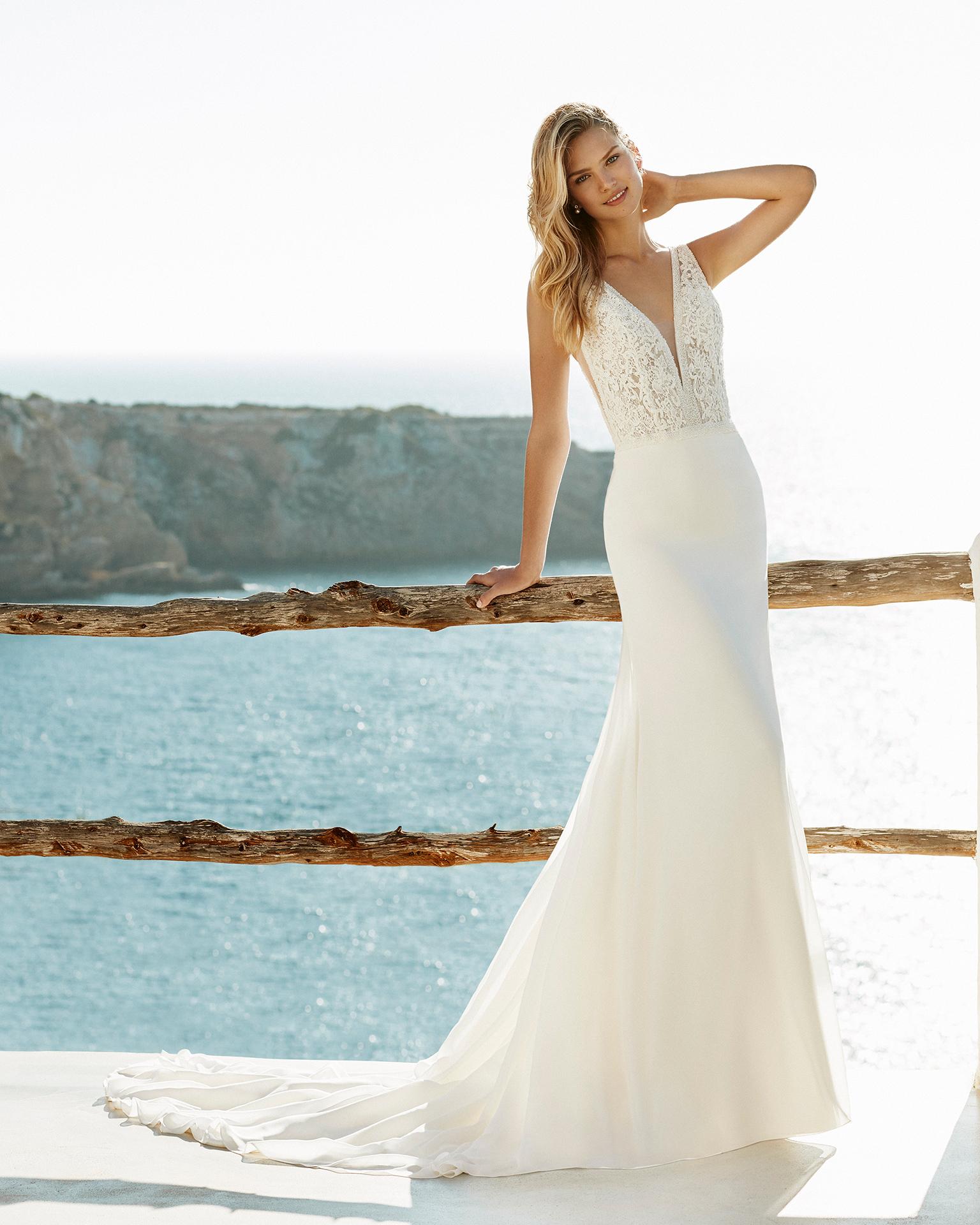 7e2aa385 ... brudekjole i lette og luftige materialer som er idéel til et  udendørsbryllup, strandbryllup eller havebryllup. Kjolerne ligger typisk i  prisniveauet kr.